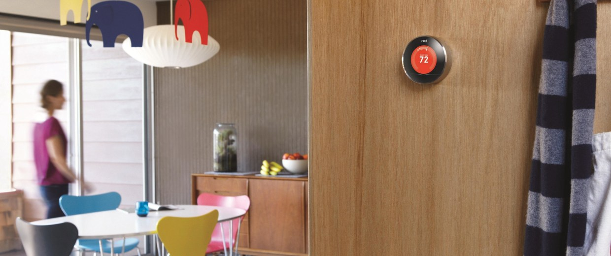 Image: A Nest device on a living room wall