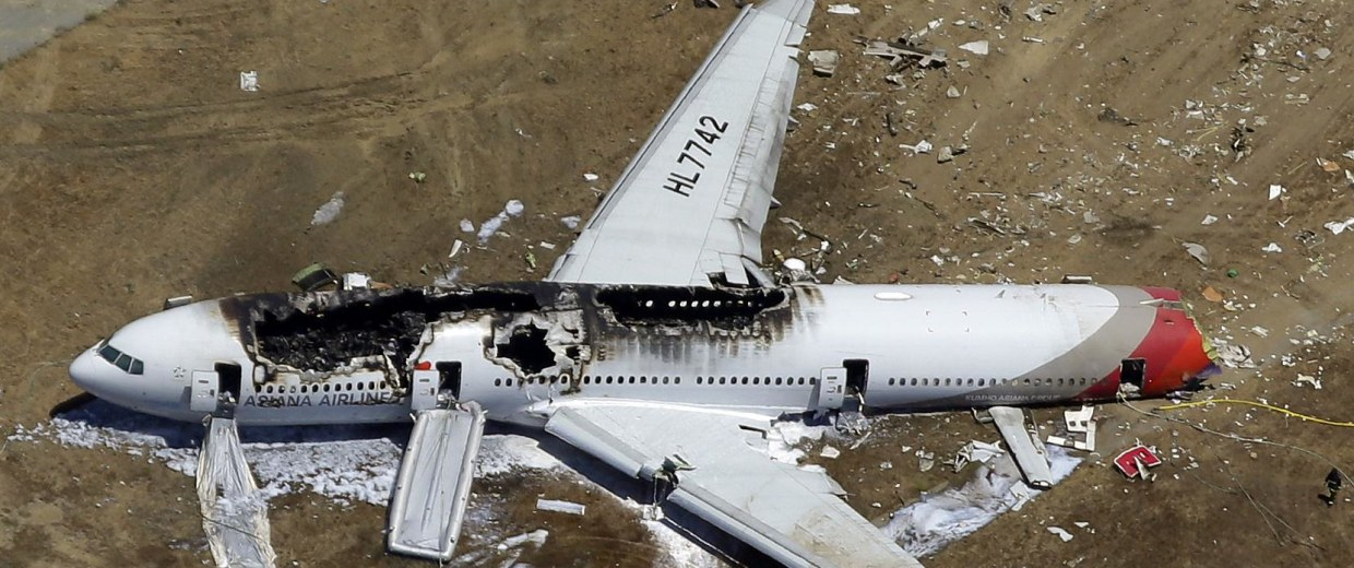 Image: The wreckage of Asiana Flight 214 lies on the ground after it crashed in July.