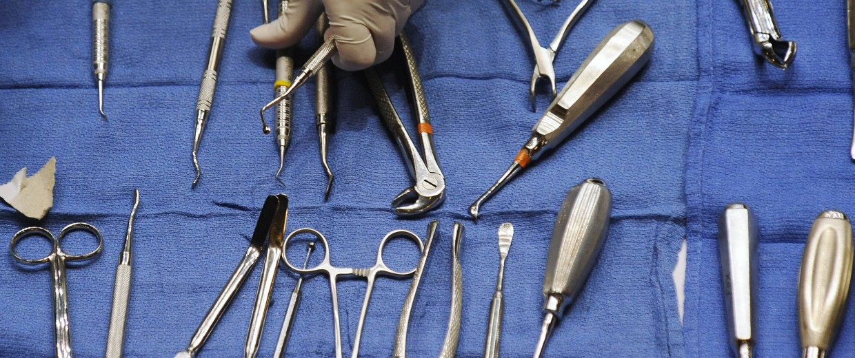 A volunteers gets dental tools for dentists