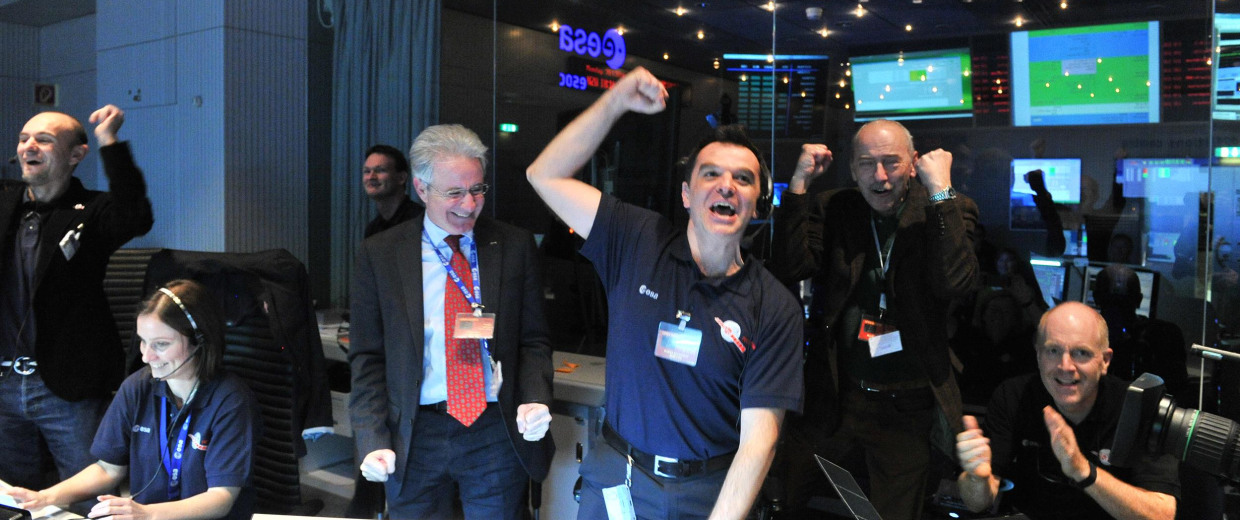Image: Rosetta mission scientists cheer as the comet-chasing probe's first signal after awaking from a 2.5-year sleep is received.