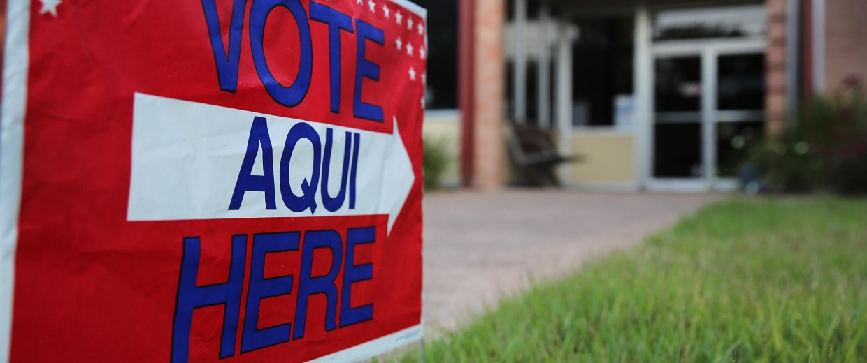 Image: An English-Spanish sign in front of a polling center in Texas