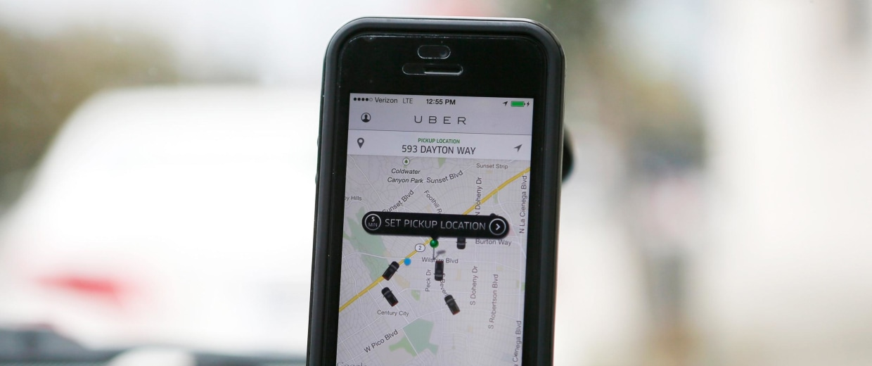 An Uber app is seen on an iPhone in Beverly Hills