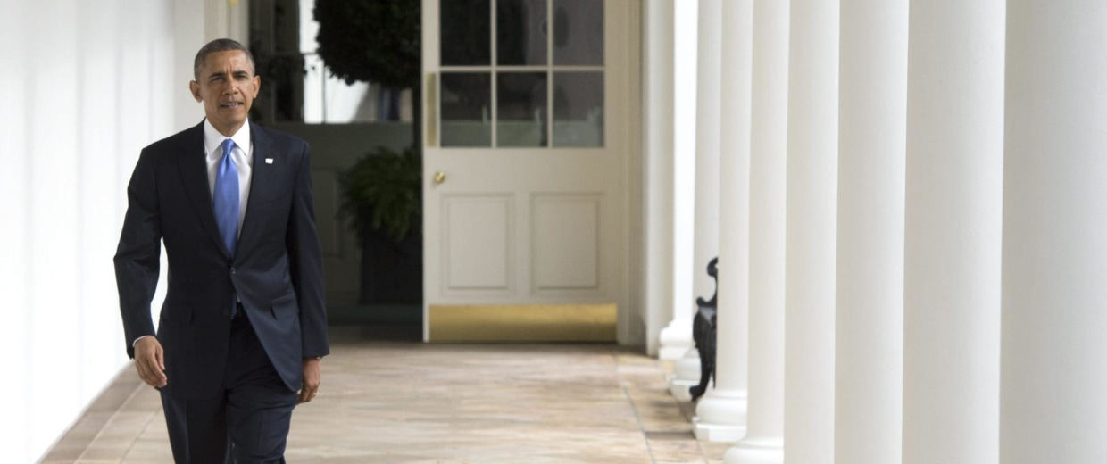 Image: US President Barack Obama walks down the Colonnade of the White House