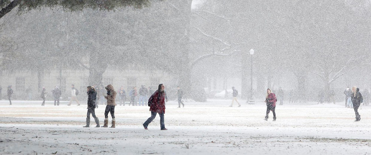Image: Students walk across the Quad after class was dismissed at the University of Alabama on Jan. 28.