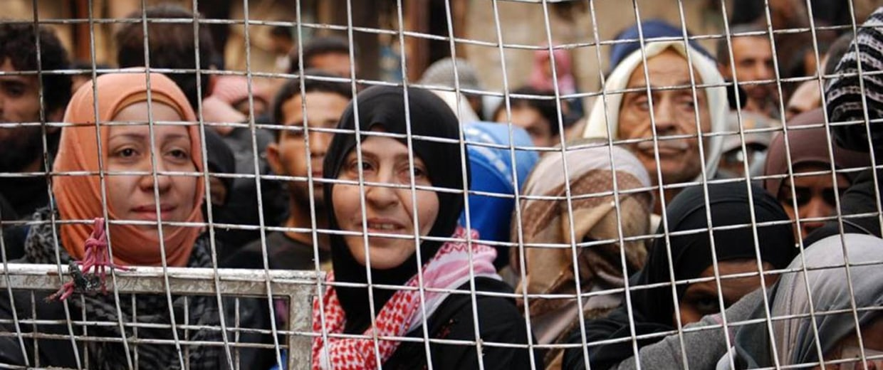 Refugees are seen at the Yarmouk Camp.