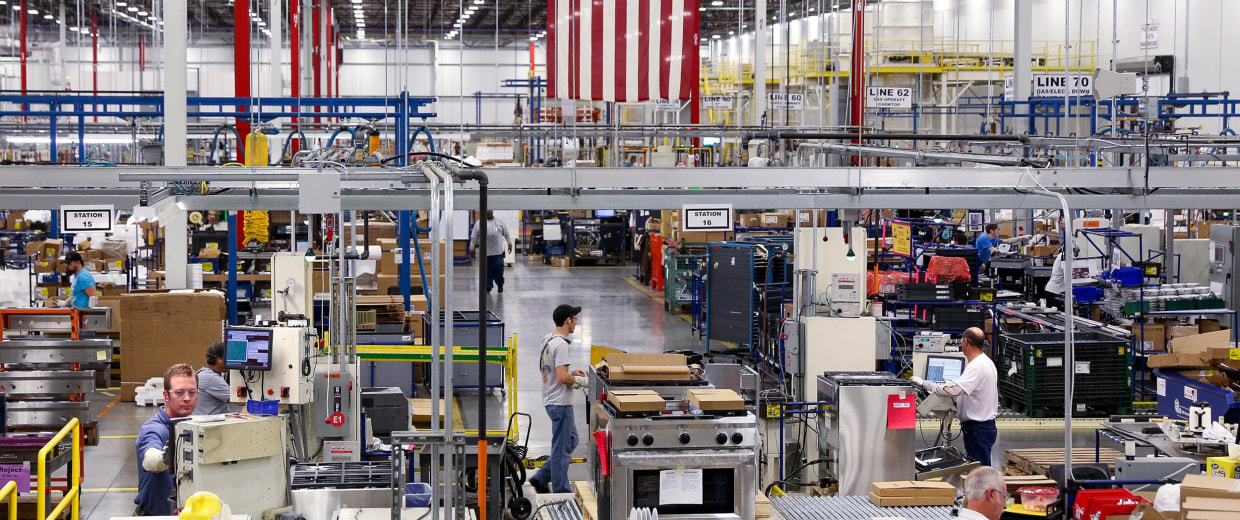 Image: Workers assemble built-in appliances at the Whirlpool manufacturing plant in Cleveland.