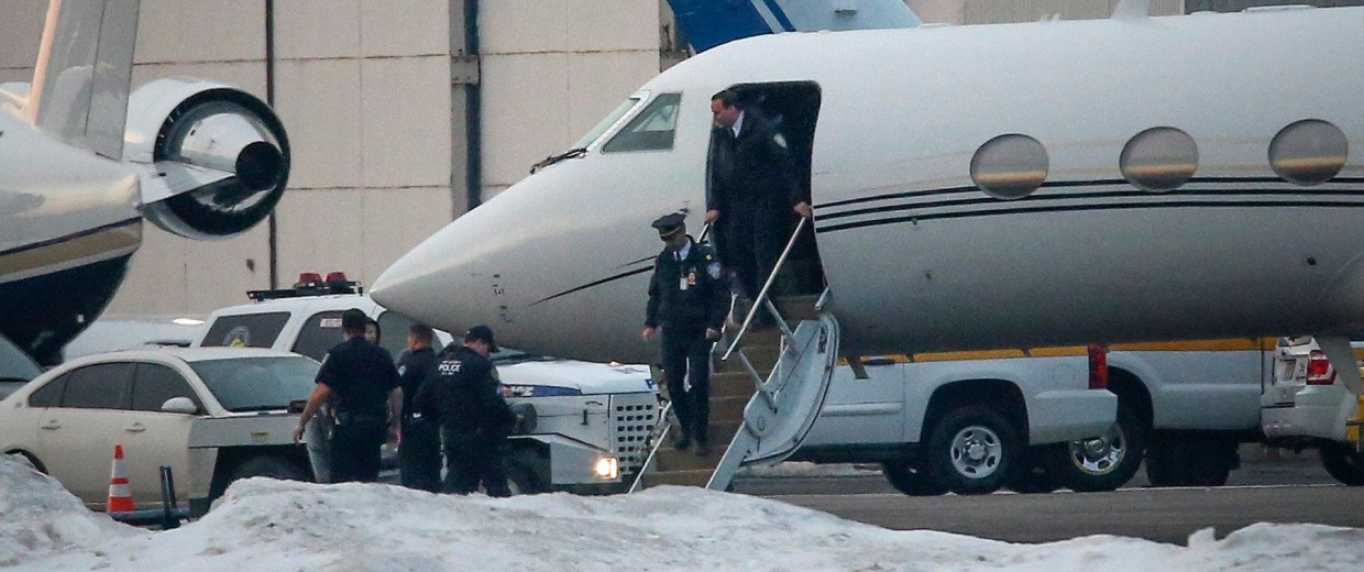 Image: Law enforcement officers leave a plane belonging to Justin Bieber that was detained at Teterboro Airport in Teterboro