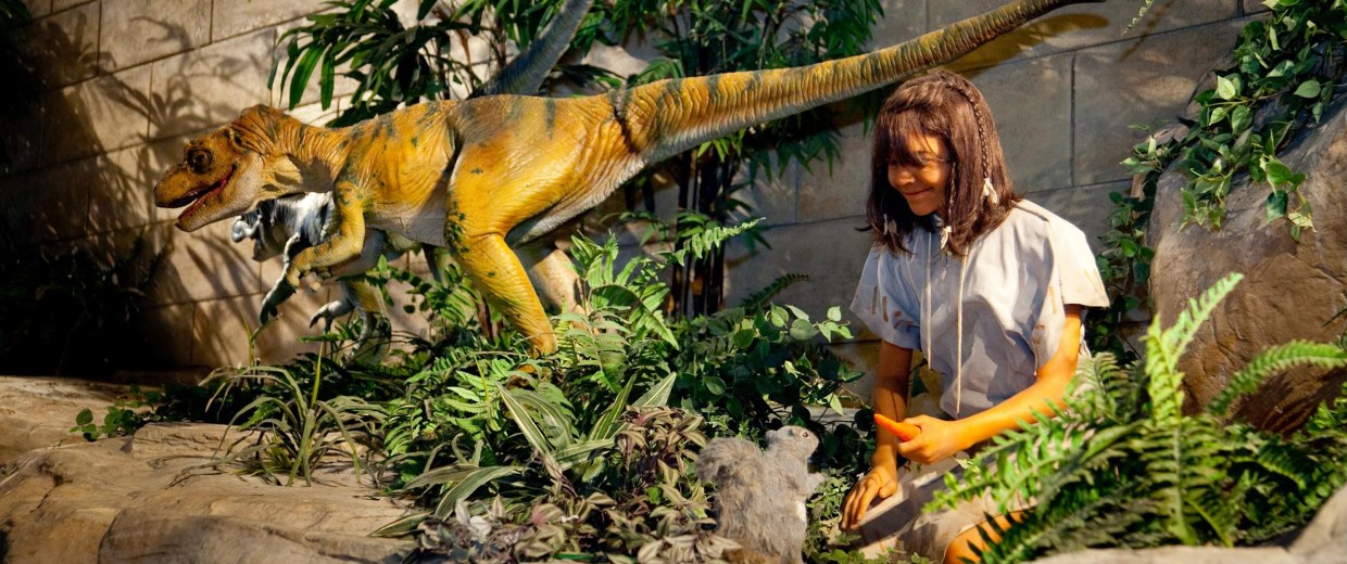 Image: Displays at the Creation Museum in Petersburg, Ky., show scenes with dinosaurs and humans living at the same time.