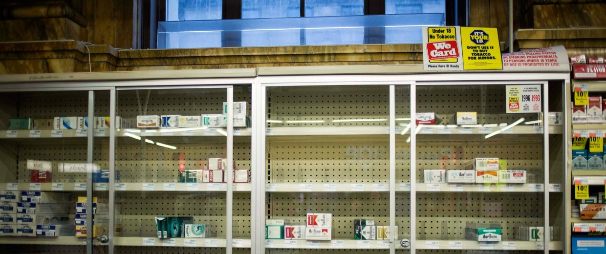 Image: Near empty cigarette shelves are seen at a CVS store in New York