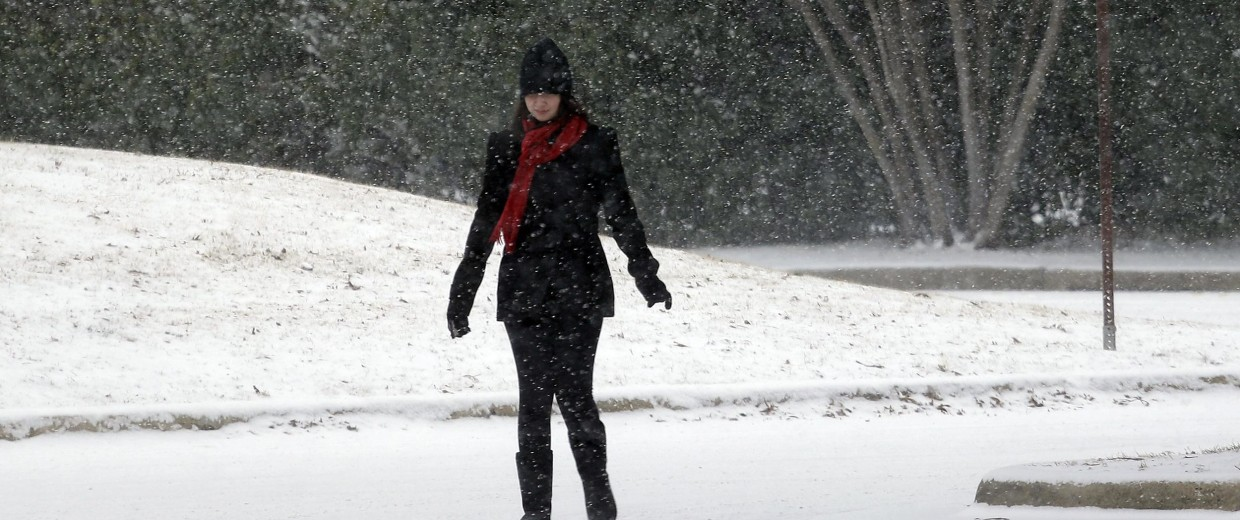 Woman walks through snow in Texas