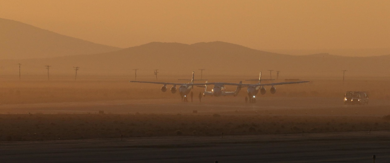 Image: Virgin Galactic's White Knight 2 with Spaceship Two prepares to take off on a test flight.