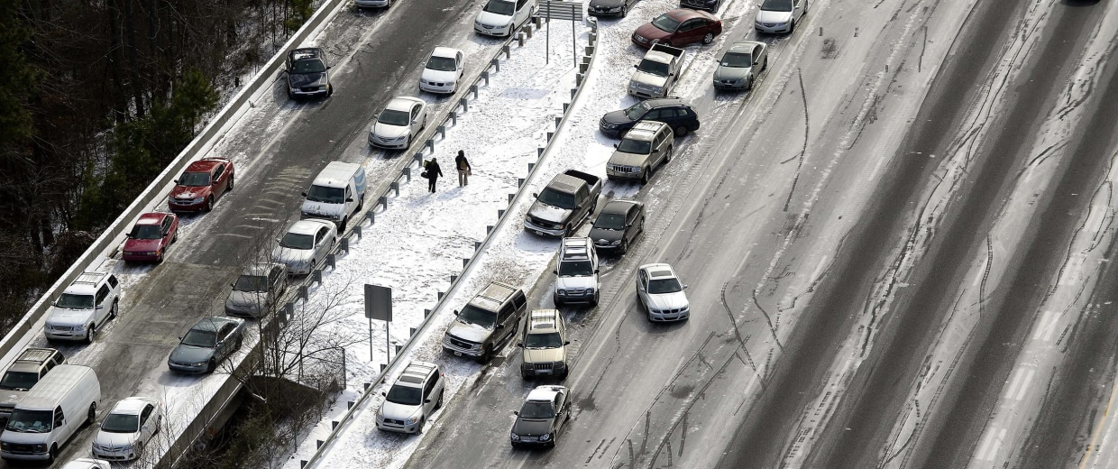 Image: In this aerial view looking at I-75 north at Mt. Paran Rd., abandoned cars are piled up on the median of the ice-covered interstate after a winter snow storm Wednesday, Jan. 29, 2014, in Atlanta.