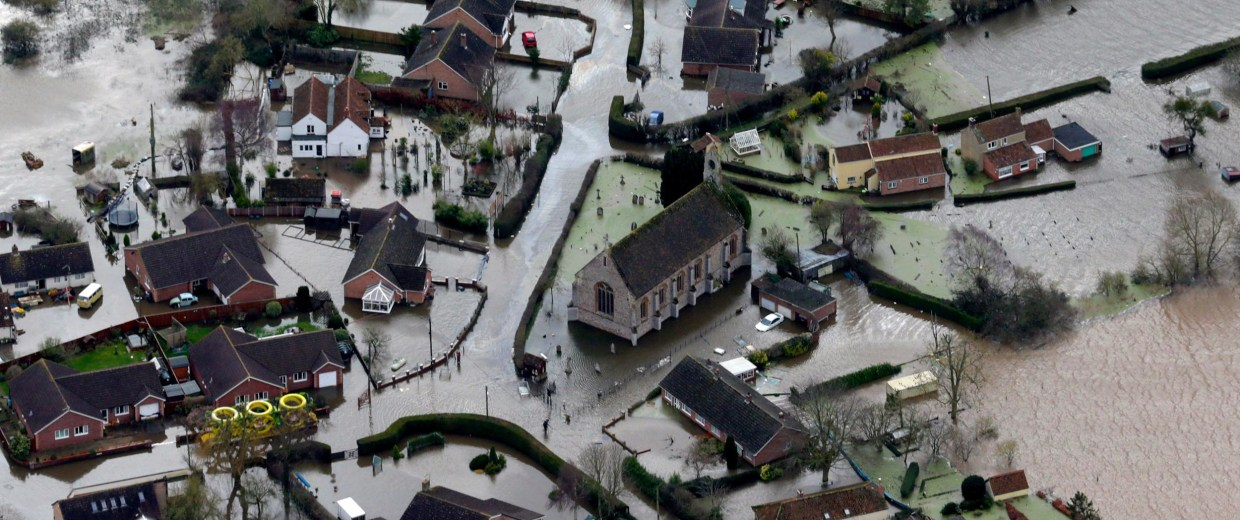 Image: Flooded properties are seen as water surrounds the village of Moorland on the Somerset Levels
