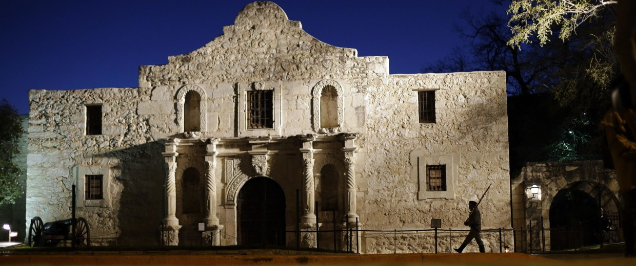 Image: A member of the San Antonio Living History Association, patrols the Alamo