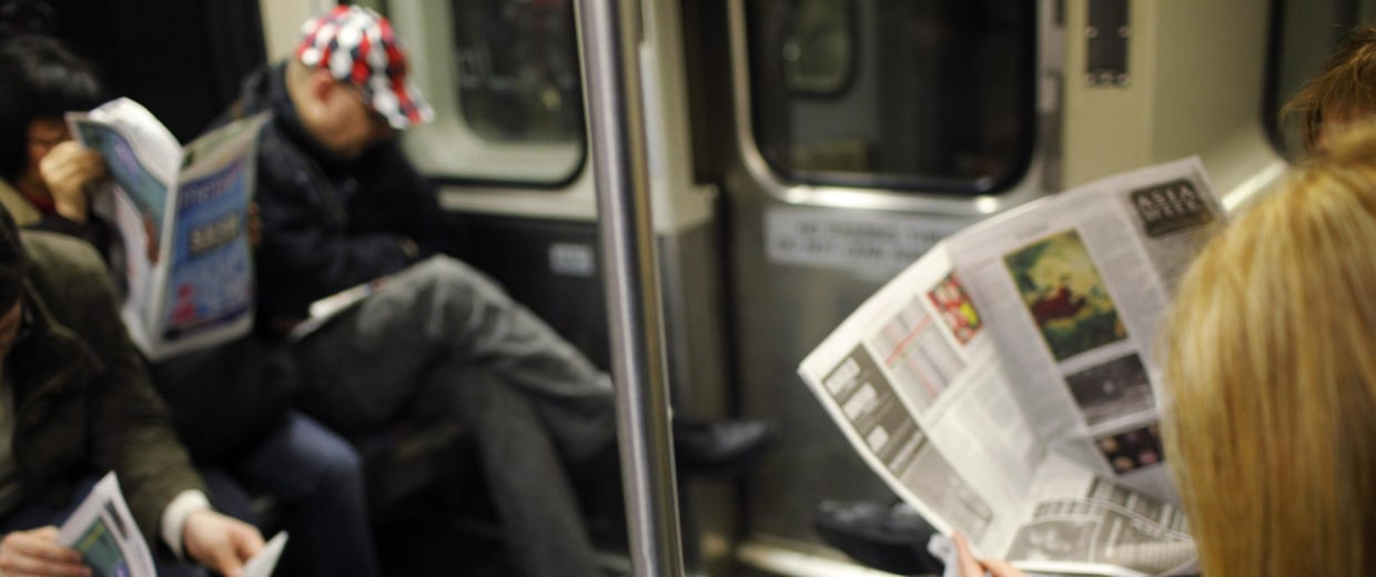 Image: A commuter reads on her Kindle e-reader while riding the subway in Cambridge, Mass.