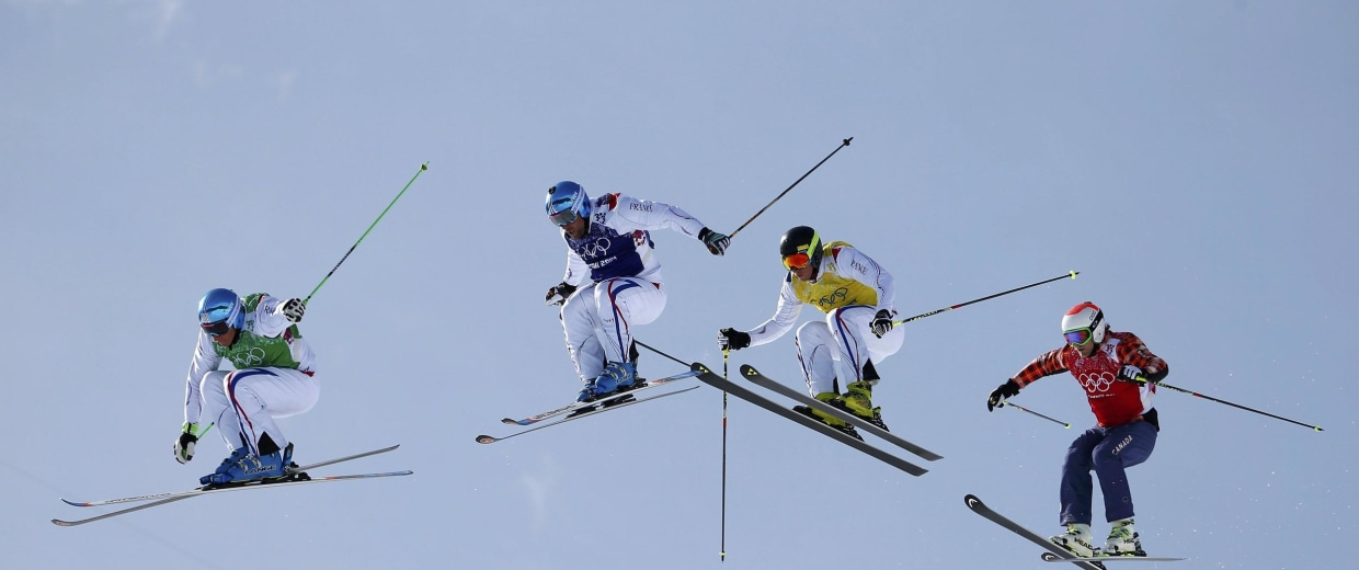 Image: France's Chapuis competes with compatriots Bovolenta and Midol and Canada