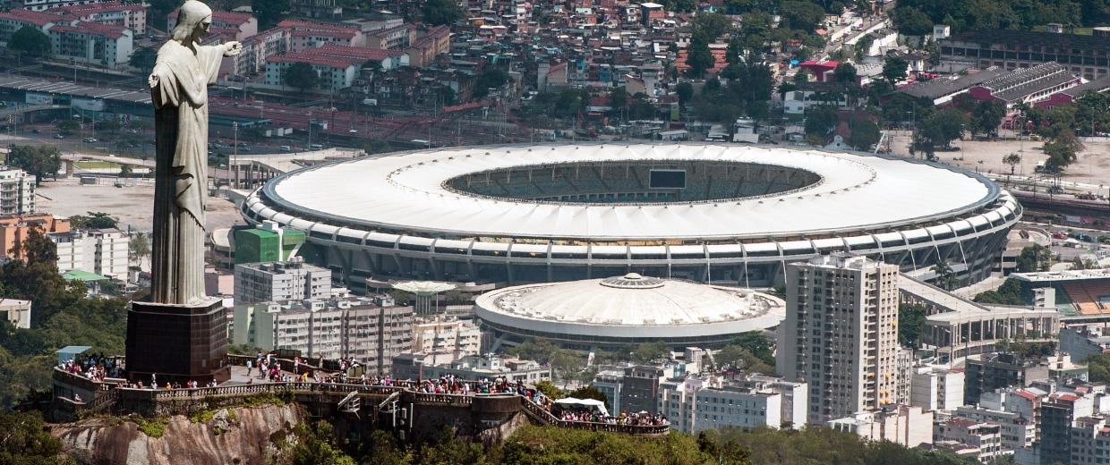 Image: Aerial view of the Christ the Redeemer statue atop Corcovado Hill and the Mario Filho stadium