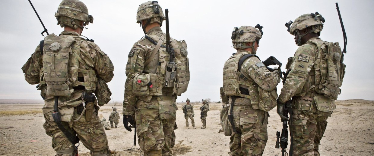 Image: Members of the U.S. Army survey the horizon after an improvised explosive device (IED) attack during a patrol outside Command Outpost AJK in Maiwand District, Kandahar Province