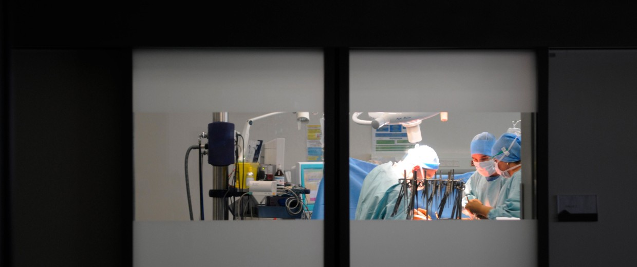Doctors perform a hystero-ovariectomy at the department of urology, operating room, Lyon Sud, France.