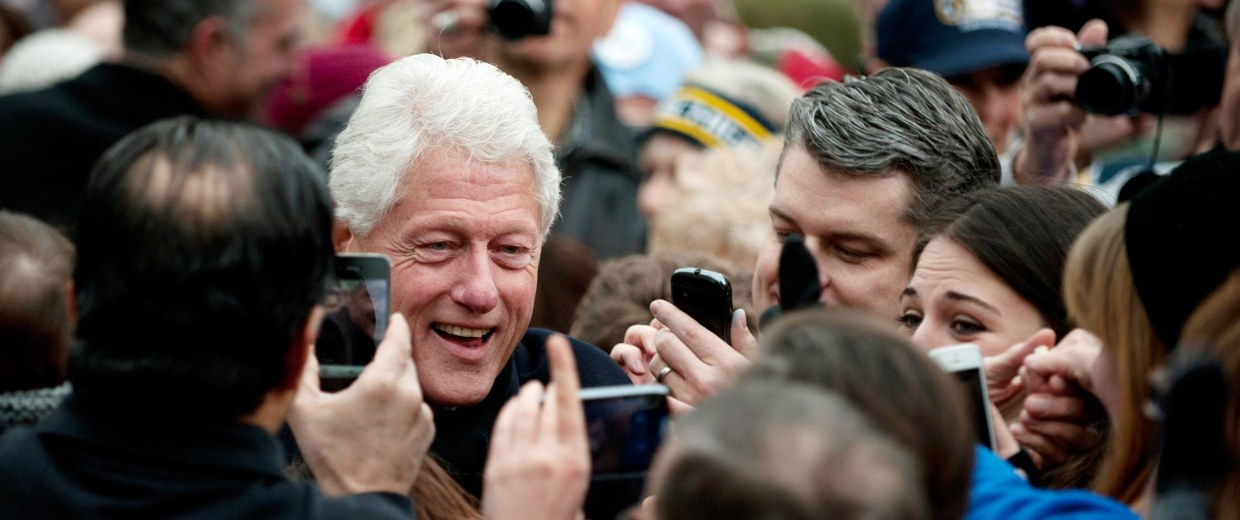 Image: Former President Bill Clinton greets supporters