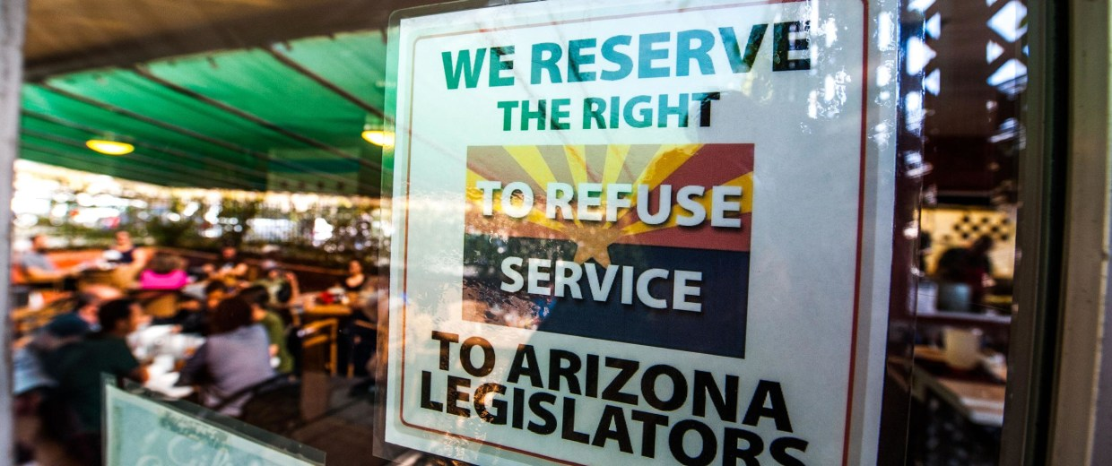 Image: Rocco's Pizza is packed a day after hanging a sign stating 'We reserve the right to refuse service to Arizona Legislators.'