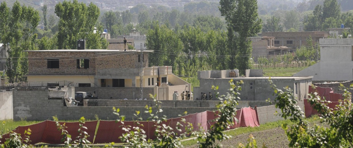 Image: Pakistani Army soldiers secure the compound where Al-Qaeda leader Osama Bin Laden was killed by the US military forces in an operation