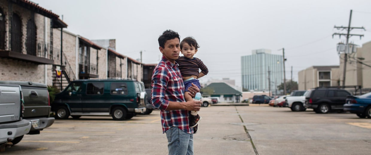 Image: Erlin Gomez and his son, outside their apartment where Gomez was arrested