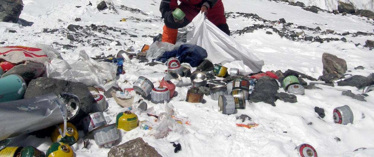 A Nepalese sherpa collecting garbage on Mount Everest.