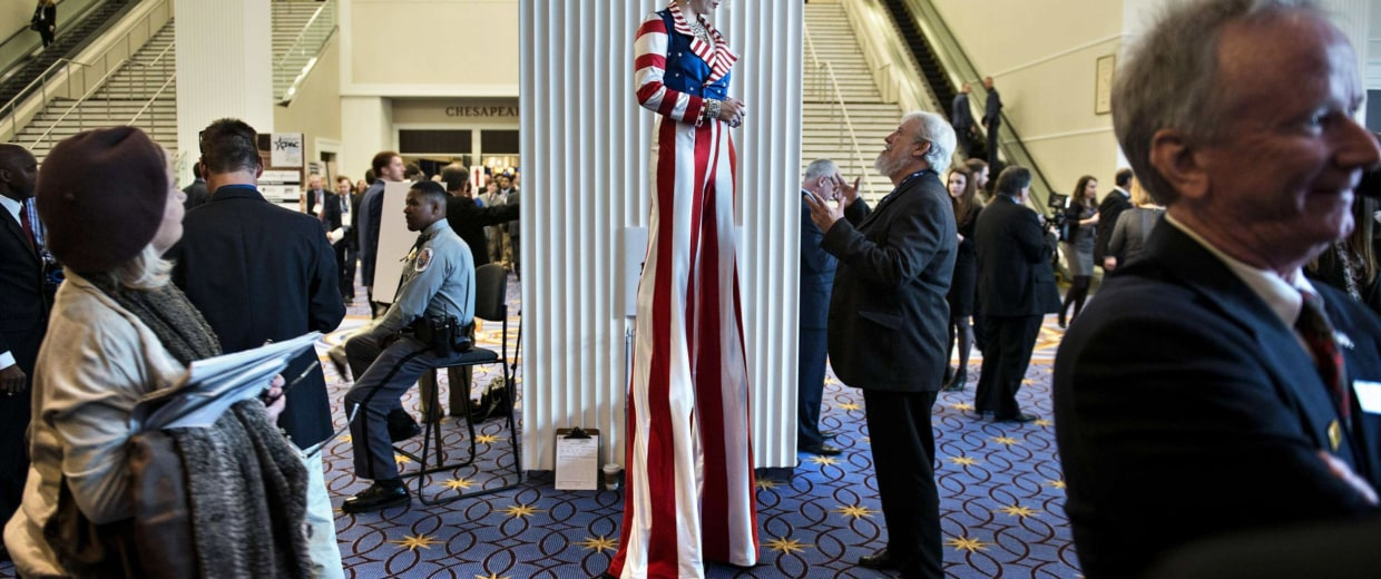 Image: People gather during a break in speakers, at the American Conservative Union Conference