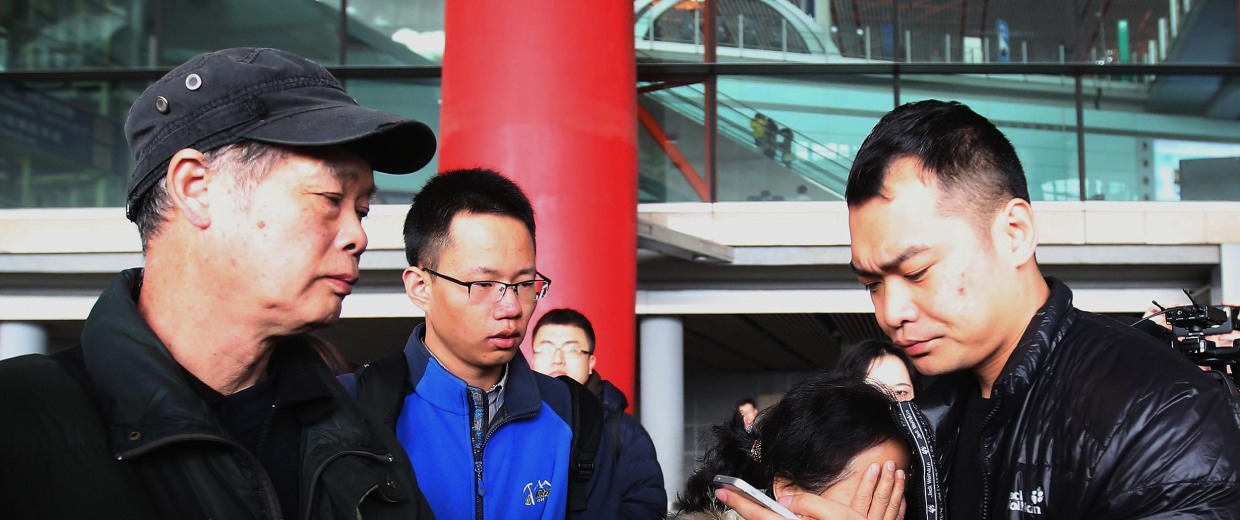 Image: A relative of a passenger on board Malaysia Airlines flight MH370 cries at Beijing International Airport