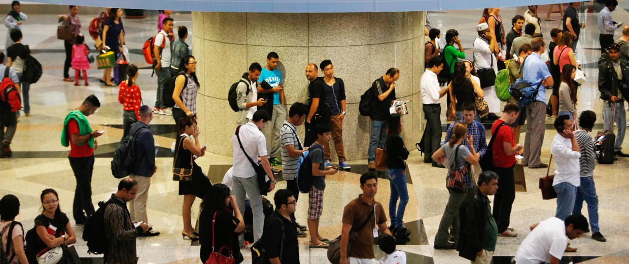 Image: Passengers queue up for customs checks at the Kuala Lumpur International Airport in Sepang