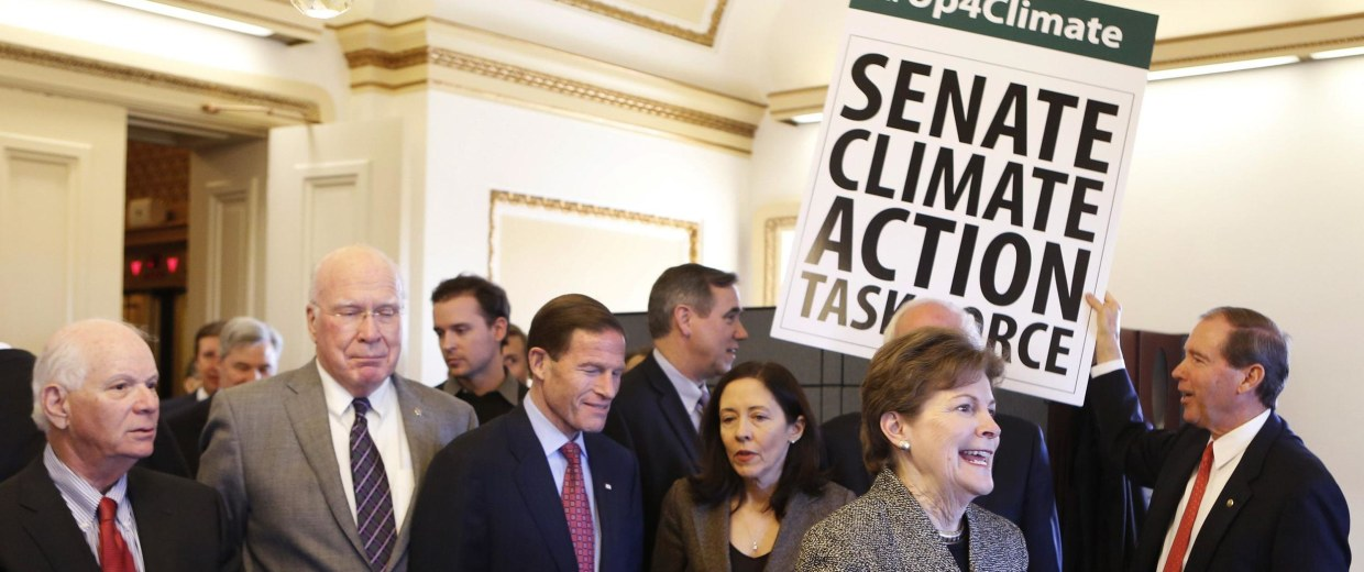 Image: U.S. Senators from the Senate Climate Action Task Force gather on Capitol Hill in Washington