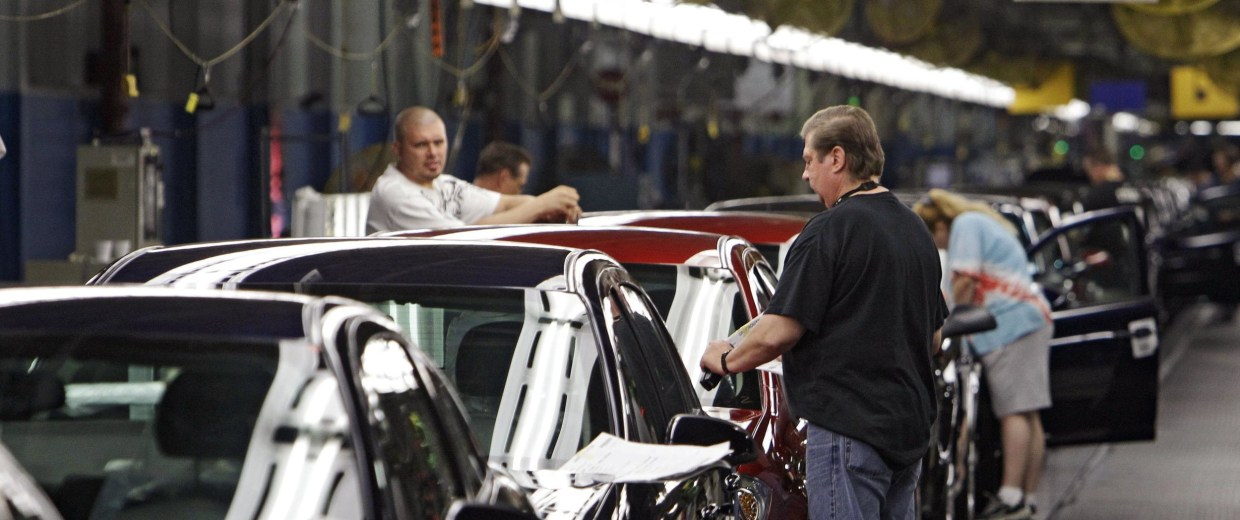 In this Tuesday, June 15, 2010, photo, workers at General Motors' Lordstown Assembly plant in Lordstown, Ohio put the final touches on Chevy Cobalts.