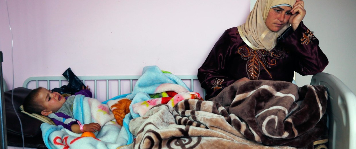 Image: Nevine Mohammed Almasre, 19-month-old, lays in her hospital bed in Chtaura's hospital in Chtaura, Lebanon