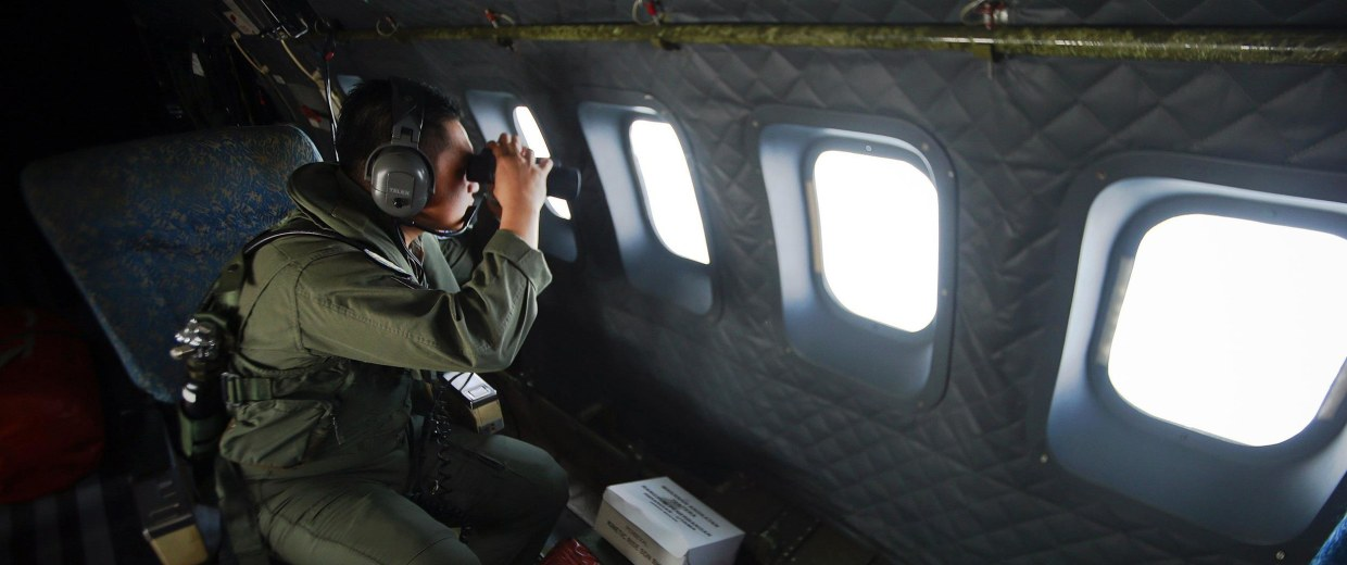 Image: A crew member from the Royal Malaysian Air Force  during a Search and Rescue operation
