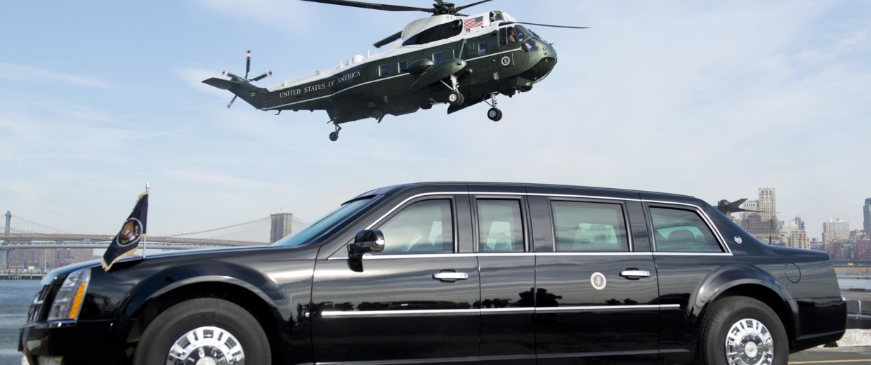 "Image: Marine One helicopter, carrying US President Barack Obama, prepares to land next to the Presidential limousine, known as ""The Beast,"""