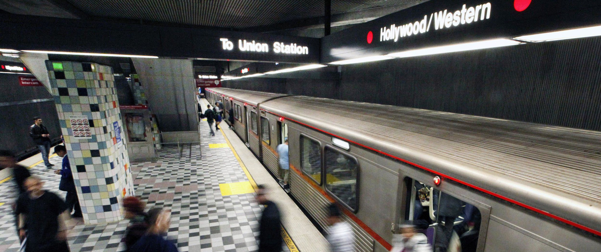 Image: Commuters enter and exit a train at the MTA Red Line Hollywood/Western station in Los Angeles