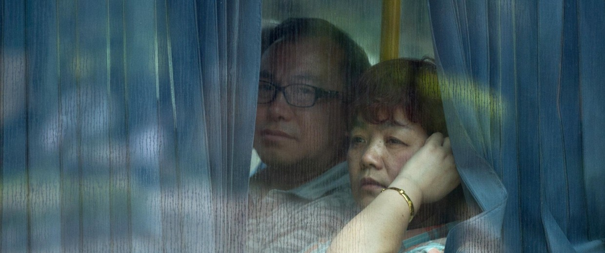 Image:Chinese relatives of passengers from the missing Malaysia Airlines flight MH370