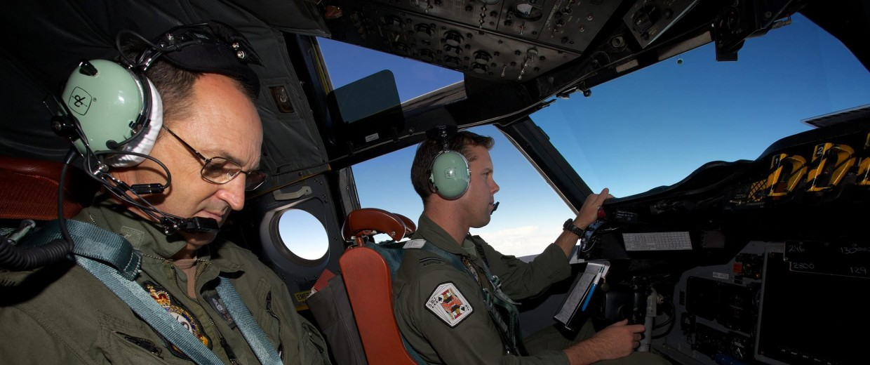 Image:  Crew on board an RAAF AP-3C Orion