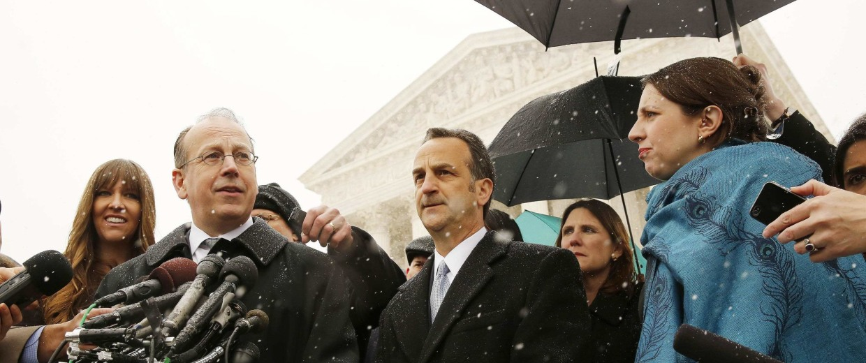 Image: Clement speaks to the press next to Cortman on the steps of the Supreme Court in Washington