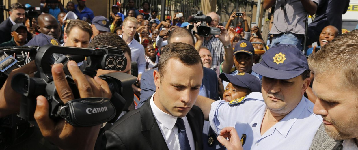 Image: South African Paralympic athlete Oscar Pistorius leaves court