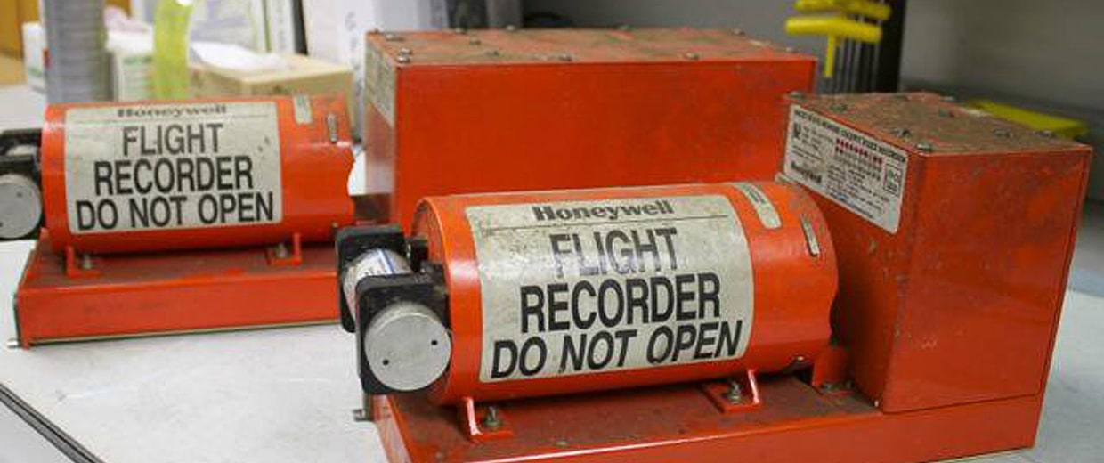 Image: This handout photo provided July 7, 2013 by the National Transportation Safety Board(NTSB), shows the Asiana flight data recorder (L) and cockpit voice recorder (R) in NTSB's Washington, DC lab.