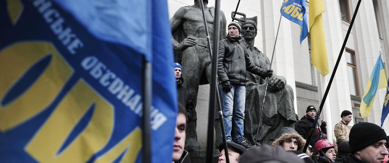 Image: People holding Svoboda party flags attend a rally  outside the parliament in Kiev