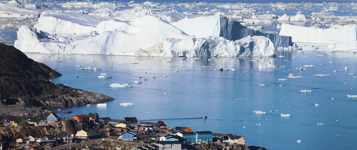 Image: The village of Ilulissat is seen near the icebergs in Greenland