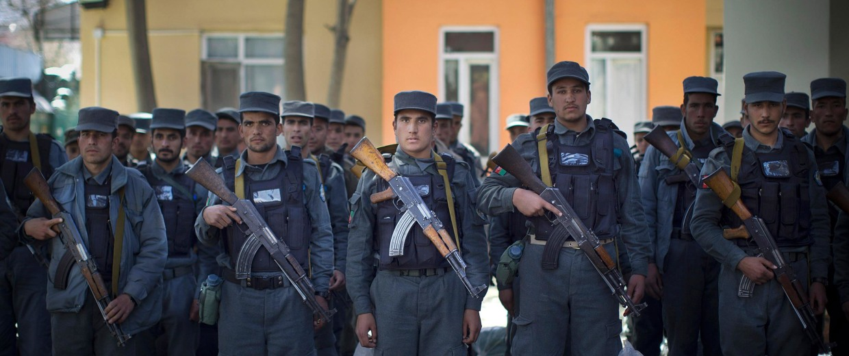 Image: Afghan police recruits who just finished their first training at the police academy, line up as they arrive with their sleeping bags at a police station in Kabul, Afghanistan