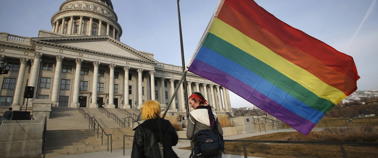 Image: Corbin Aoyagi and Jerusha Cobb walk to join supporters of same-sex marriage rally at Utah's State Capitol building in Salt Lake City