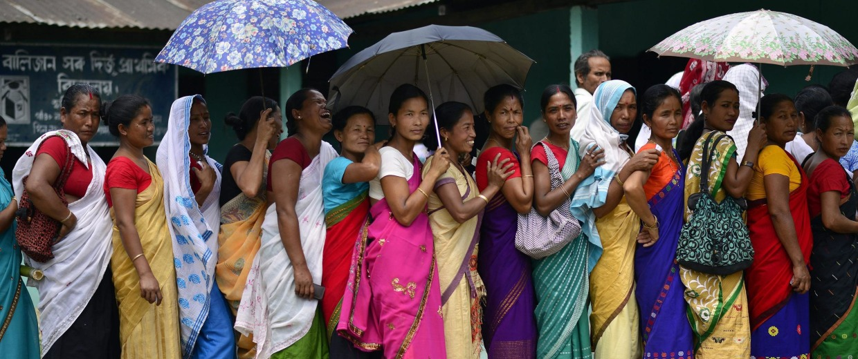 Image: Voters line up in India's Lakhimpur district on Monday