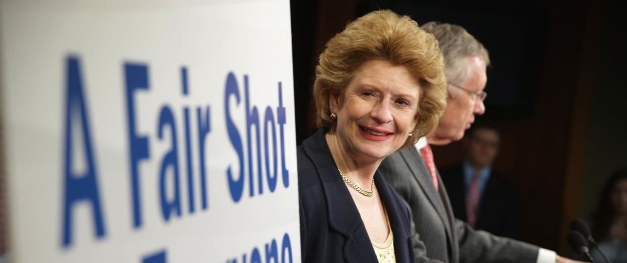 U.S. Sen. Debbie Stabenow (D-MI) looks at a poster during a news conference March 26, 2014 on Capitol Hill in Washington, DC.