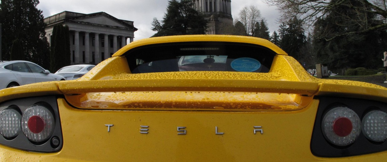A lawyer is challenging electric carmaker Tesla's unique sales plan, says it runs afoul of state lemon laws