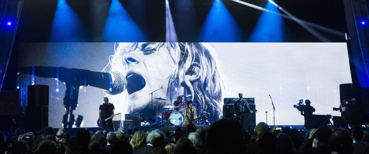 Image: Singer Jett performs with remaining members of band Nirvana